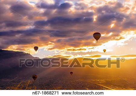 Stock photography of hot air balloons flying at sunrise with the stock photography hot air balloons flying at sunrise with the sandia mountains in the background sciox Choice Image