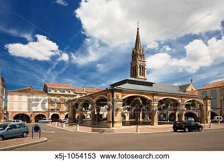 Stock photo of the covered market square at valence d agen for Photo sunshine valence