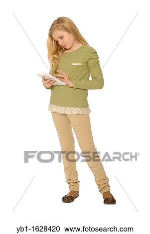 Stock Photography - Ten year old girl standing up and using computer tablet  or e reader