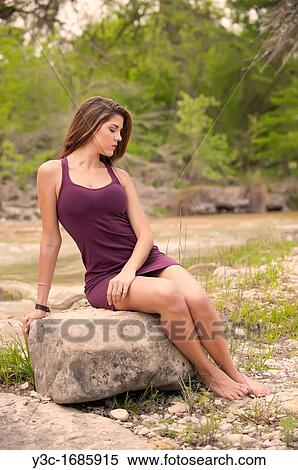 Stock Image of Young female model barefoot in natural setting close to a river y3c-1685915 ...