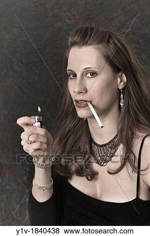 Picture - Young woman lighting a cigarette. Fotosearch - Search Stock Photos Images  sc 1 st  Fotosearch & Pictures of Young woman lighting a cigarette y1v-1840438 - Search ... azcodes.com