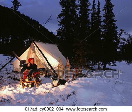 Stock Photo - Man talking on Cell Phone Wall Tent Nenana River AK Interior winter. & Stock Photo of Man talking on Cell Phone Wall Tent Nenana River AK ...