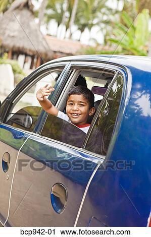 Waving goodbye from car