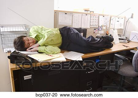 Stock Photography of Man asleep on his desk bcp037-20 ...