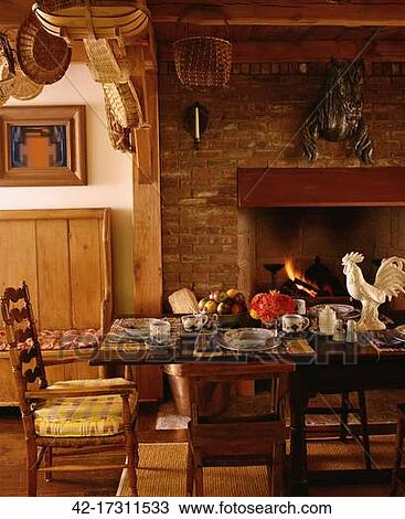 Stock photo of traditional dining room with brick for Traditional dining room fireplace