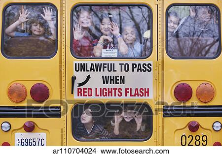 Stock Photo of Kids Looking Out Rear Window of School Bus ...