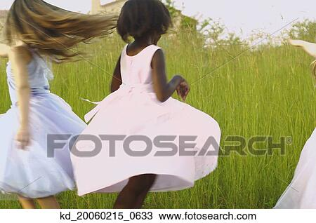 Stock Photo of Young girls wearing party dresses and ...