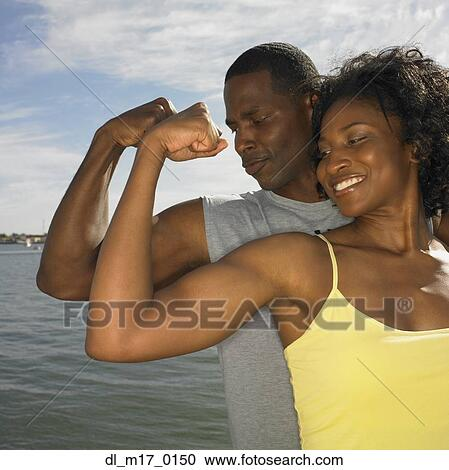 Banques de photographies africaine couple dans for Exterieur biceps