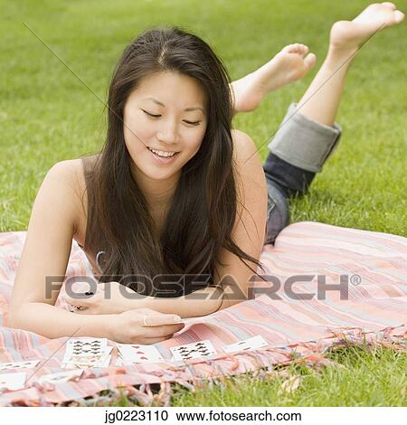 Stock Photography Of Asian Woman Playing Solitaire On
