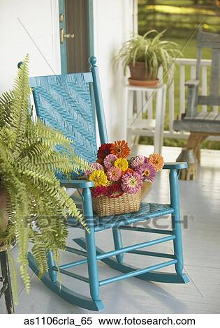 Stock Image Of Basket Of Flowers And Rocking Chair On