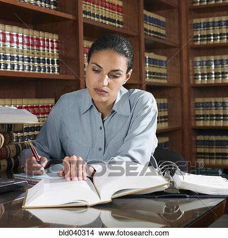 Stock Photo of Hispanic female lawyer working in office ...
