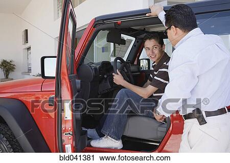 Stock Photography Of Hispanic Father And Son Looking At New Cars