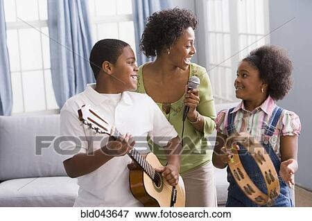 Picture Of African American Mother And Children Playing