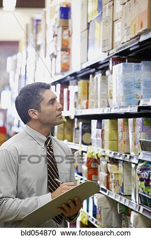 stock photography of hispanic grocery store manager