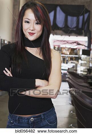 banque de photo femme asiatique bras crois s bld056482 recherchez des images des. Black Bedroom Furniture Sets. Home Design Ideas