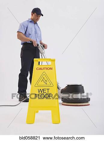 Stock Graphy Hispanic Man Cleaning Floor Bld