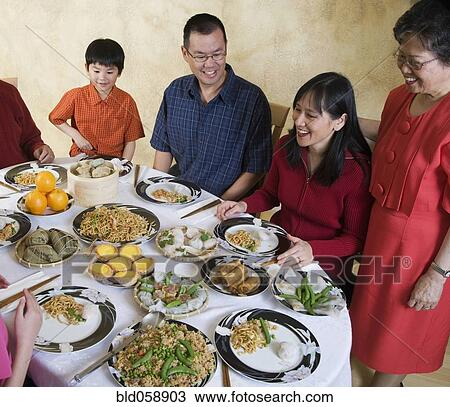 Stock Photo Of Asian Family Eating At Dinner Table