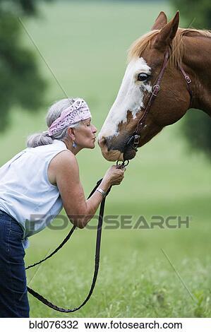 Stock Photo Of Hispanic Woman Kissing Horse Bld076332