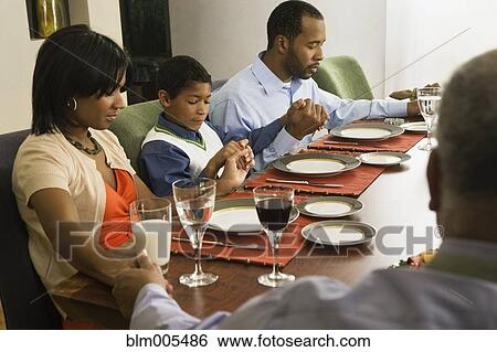 Stock Images Of African American Family Saying Grace At Dining