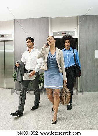 people in elevator clipart. business people leaving elevator in clipart