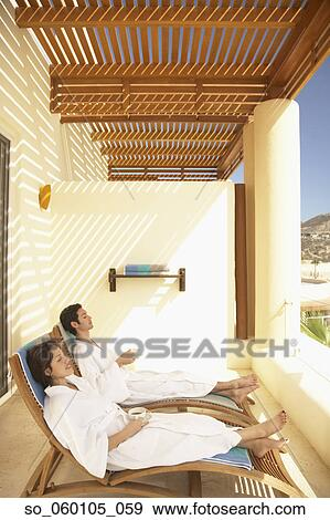 Stock Photograph Of Couple Relaxing On The Balcony At A Resort Hotel Los Cabos Mexico So