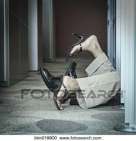 Stock Photography of Business people's feet poking out office ...