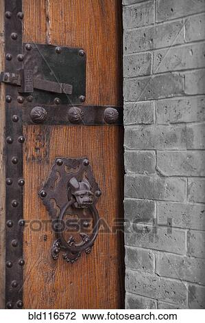 Stock Photo   Wooden Door With Ornate Door Knocker. Fotosearch   Search  Stock Photography,
