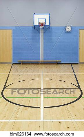 Stock photo of basketball court markings and hoop in the for Sport court basketball hoop