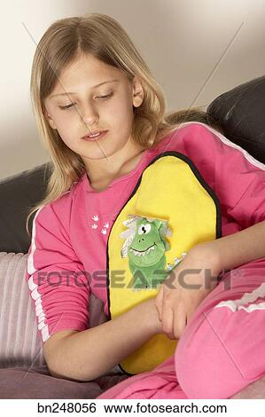 Stock Images of Girl holding hot water bottle bn248056 ...
