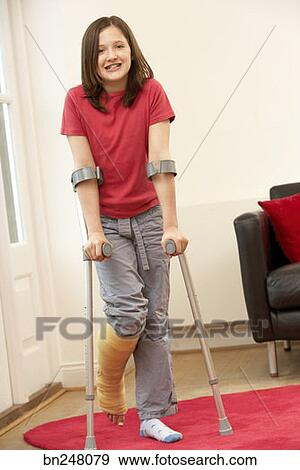 Stock Photograph - Girl using forearm crutches  Fotosearch - Search    Using Forearm Crutches