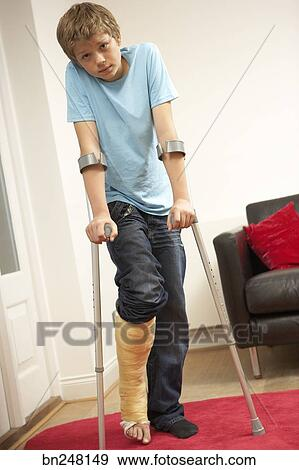 Stock Photograph - Teen boy using forearm crutches  Fotosearch    Using Forearm Crutches