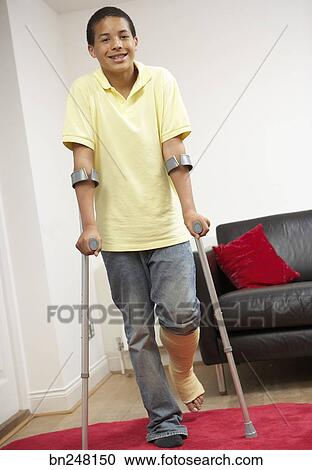 Stock Photography - Teen boy using forearm crutches  Fotosearch    Using Forearm Crutches