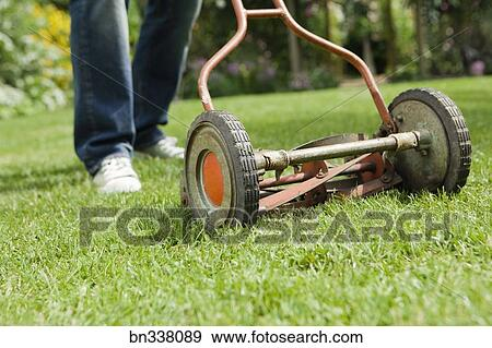 stock photograph of old fashioned lawn mower bn338089 search stock photography posters. Black Bedroom Furniture Sets. Home Design Ideas