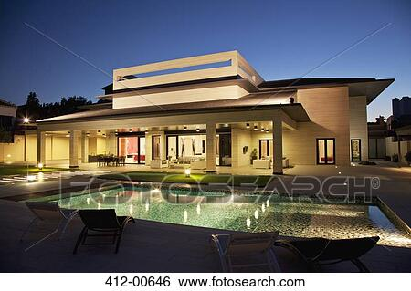 Luxury House And Swimming Pool Illuminated At Night View Large Photo