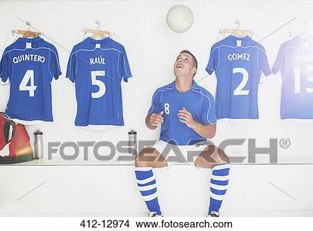three footballers in the locker room