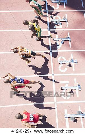 Picture of Sprinters taking off from starting blocks on track 412 ...
