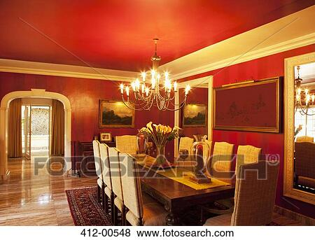 Pictures of chandelier over dining table in luxury dining room 412 picture chandelier over dining table in luxury dining room fotosearch search stock photos aloadofball Image collections