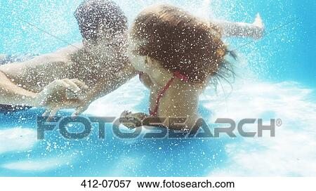 Picture Of Couple Kissing In Swimming Pool 412 07057 Search Stock Photography Photos Prints