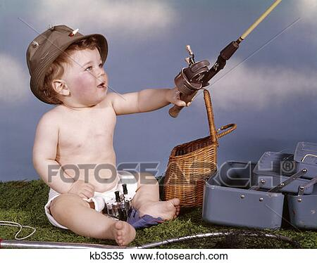Stock image of baby with fishing hat and gear holding for Baby fishing pole