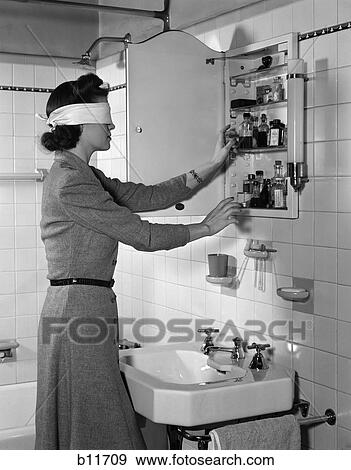 Stock Photograph of 1940S Woman Wear Blindfold Reaching Into ...