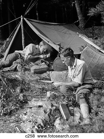 Picture - 1920S Two Men At Primitive C&site One Man In A Frame Tent Lighting Cigarette  sc 1 st  Fotosearch & Pictures of 1920S Two Men At Primitive Campsite One Man In A Frame ... azcodes.com