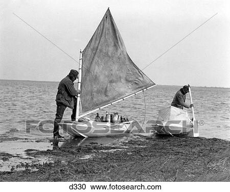 Stock Photography   1930S Two Men Small Boats Duck Decoy Preparing To Go Duck  Hunting Shooting Part 47