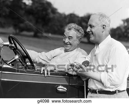 Pictures Of 1920s 1930s 2 Senior Men One Sitting Driving