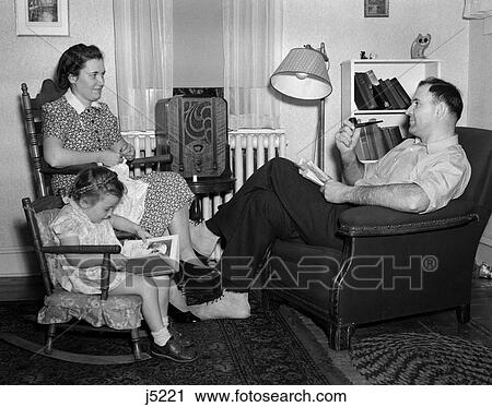 Stock Photography Of 1930s 40s Family Relaxing Near Radio