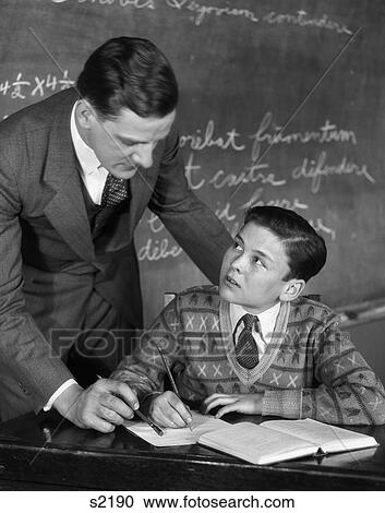 Stock Photography Of 1920s Classroom Male Teacher Helping