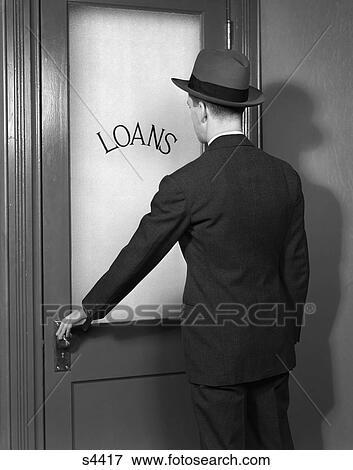Picture - 1930 1930S 1940 1940S Man In Suit And Hat Opening Door Marked Loans . & Picture of 1930 1930S 1940 1940S Man In Suit And Hat Opening Door ... Pezcame.Com