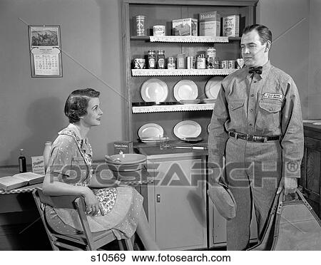 Stock Photograph of 1950S Woman Apron Sitting At Kitchen ...