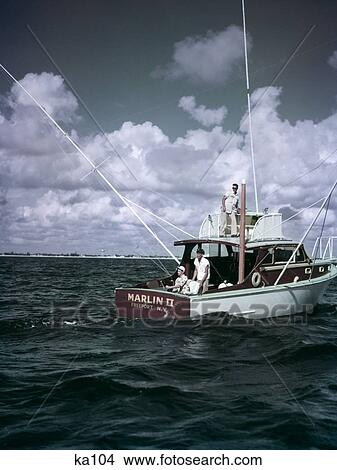 Stock photo of 1950s 3 men on charter fishing boat marlin for Freeport fishing boats
