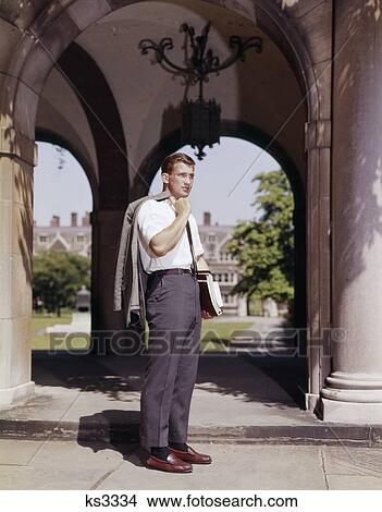 Stock Photo of 1960S Male College Student Standing By ...