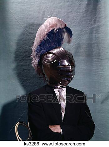 Stock image of 1960s business man wearing 16th century medieval type